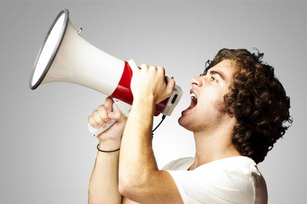 Young man with a megaphone.