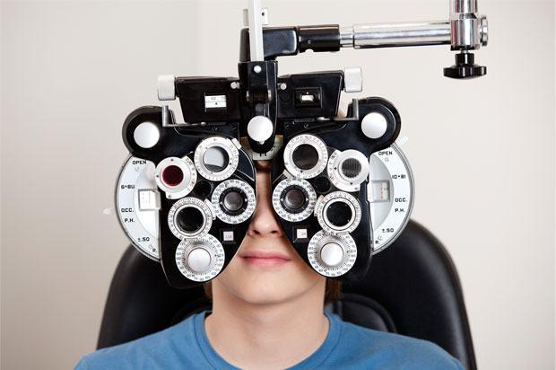boy sitting having an eye test