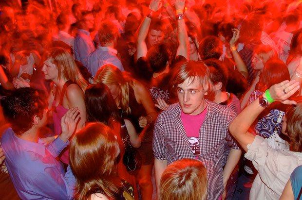 boy unhappy in club