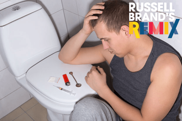 Boy sat by toilet, with drug paraphernalia