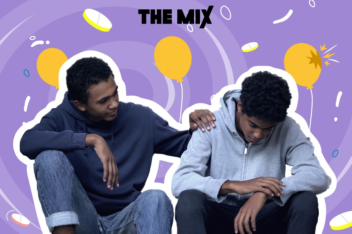 A young person is sitting down looking worried, while another young person comforts them during a drug emergency. In the background there are balloons.