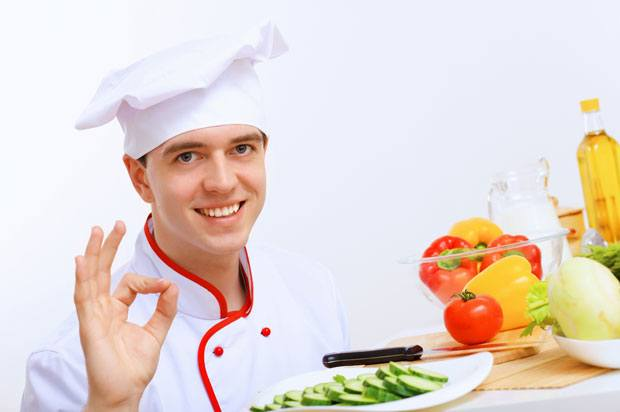 Chef holding a plate of cucumber