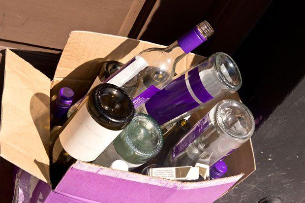 Empty wine bottles in a cardboard box