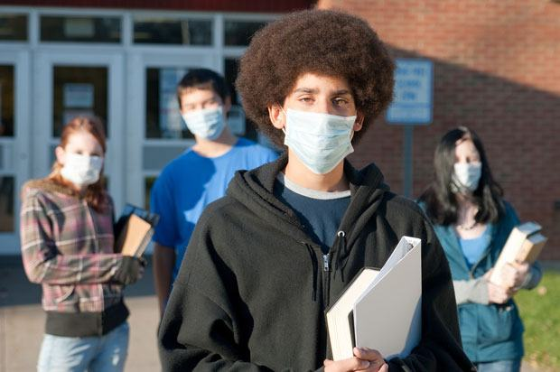 students wearing germ masks