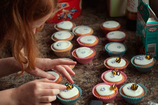 Girl decorating cupcakes