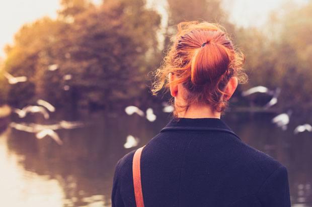 girl looking at lake