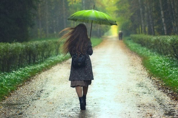 girl walking with umbrella