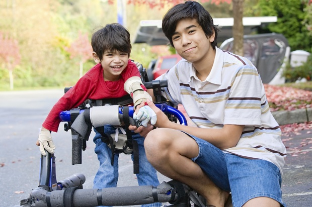 young man with disabled brother