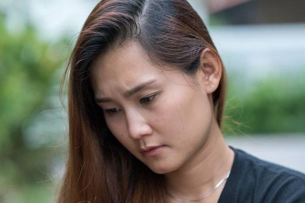 Woman looks sad and upset.