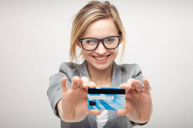 Girl holding debit card