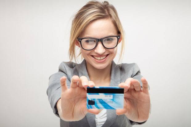 Girl holding debit card