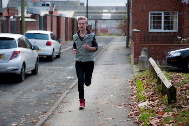 Guy running along the street