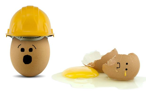Broken egg in a hard hat