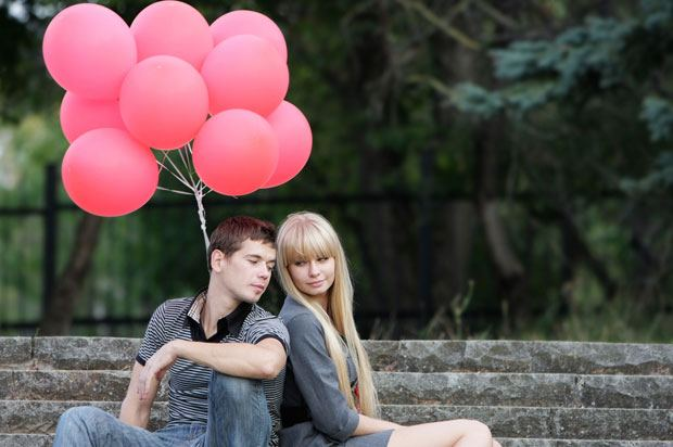 couple with red balloons