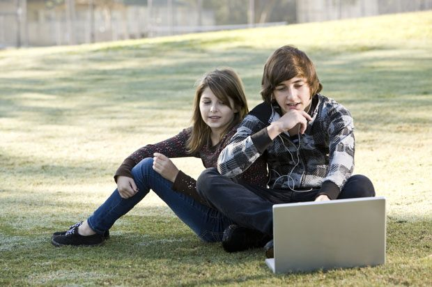 Girl and boy on a laptop