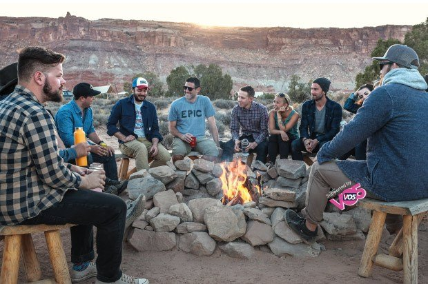 Group of travelers sitting round a fire