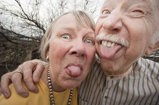 old people pulling a face