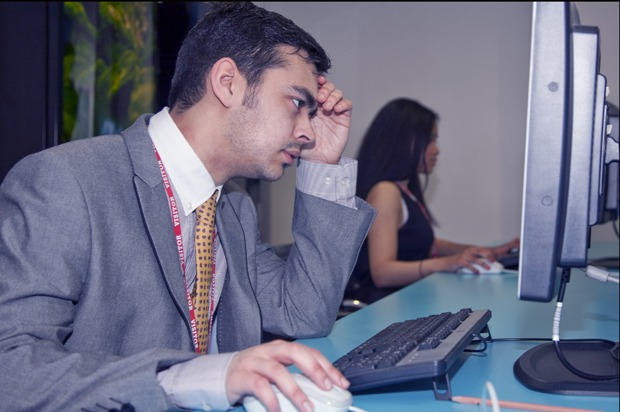 Boy looking stressed on a computer