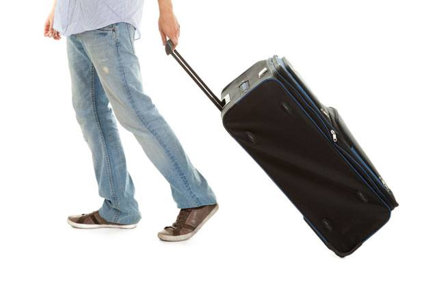 Someone dragging a suitcase