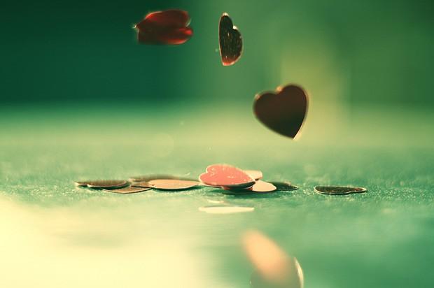 Heart sequins falling through the air.