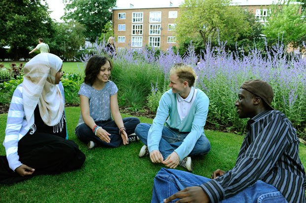 Group of young people sitting and talking