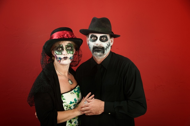Middle-aged couple in gothic clothing and make-up