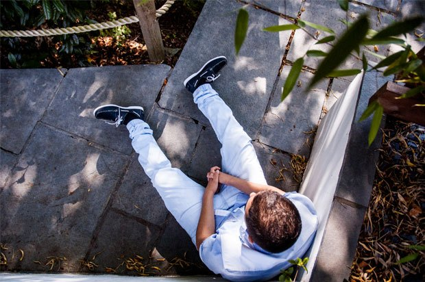 Boy sat on patio, photo taken from above