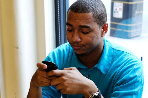 Boy snooping on a phone