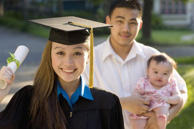 Woman graduating with baby