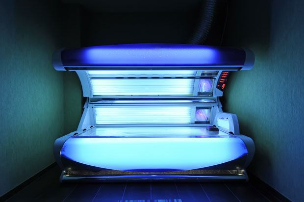 An open sunbed emitting blue light
