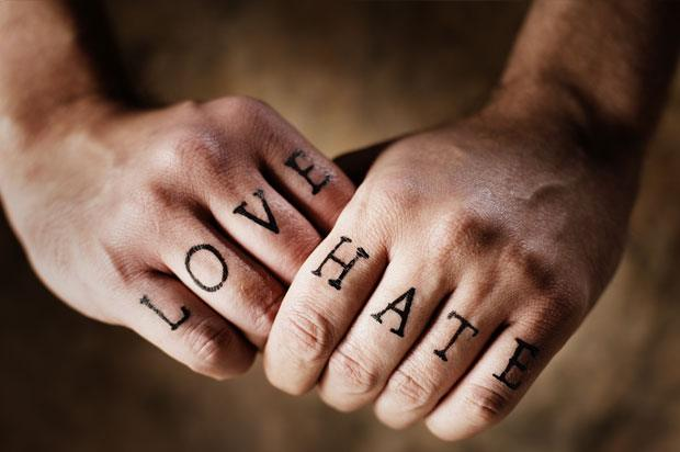 Tattoo of knuckles with the words 'love' and 'hate' tattoed onto them