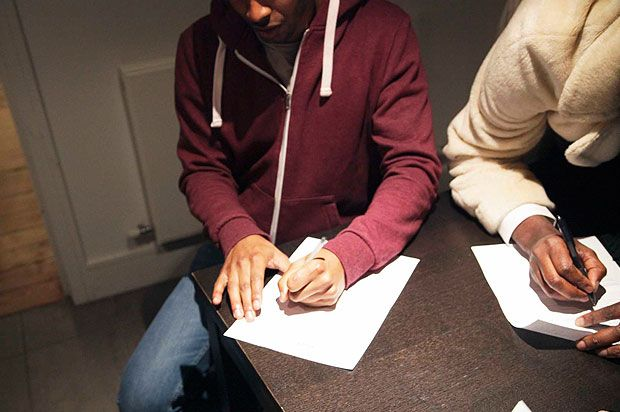 boy signing contract