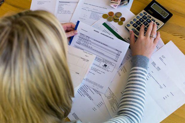 girl doing bills