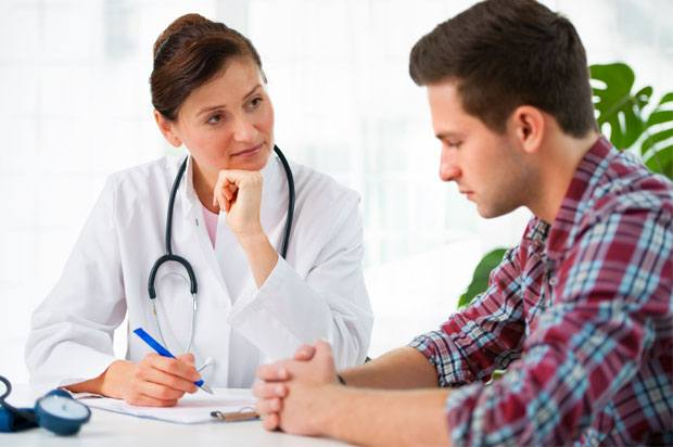 boy talking to doctor