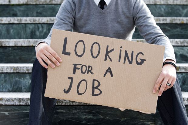 boy holding job sign