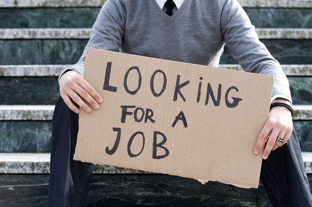 boy holding job sign