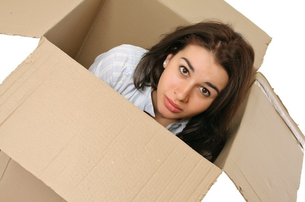 Girl sat in a box.