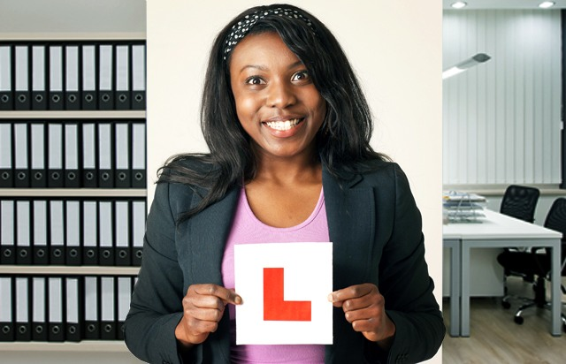 Girl holding an L plate