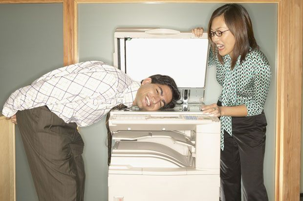 boy and girl messing with the photocopier