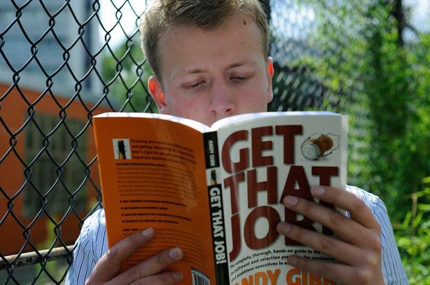 Boy reading an employment book