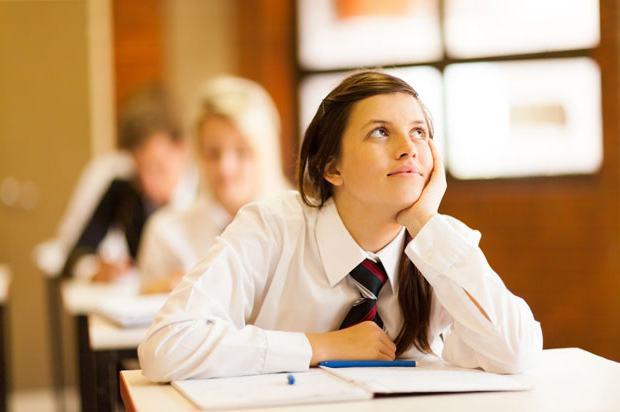 Girl dreaming of leaving school