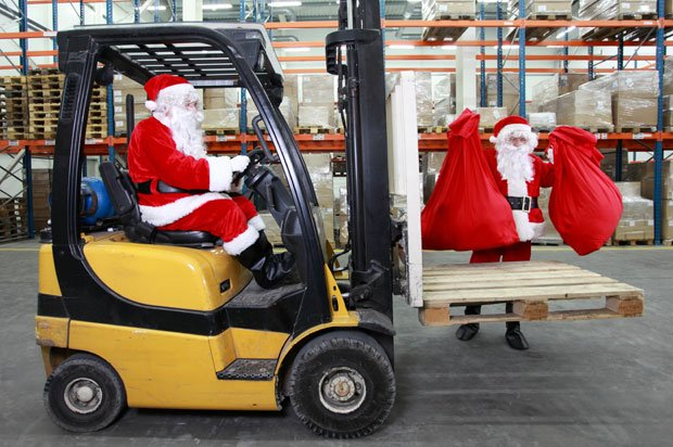 Two santas working in a factory