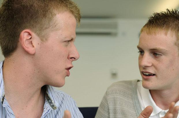 two blonde boys having an argument