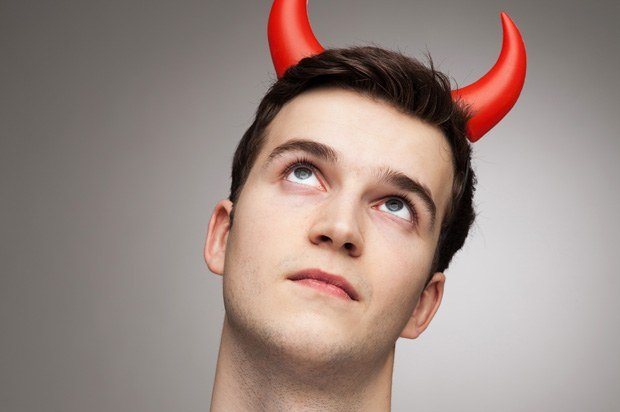 Man looking angelic with devil horns.