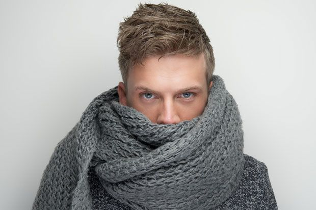 Boy wrapped in scarf