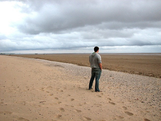 boy standing on beach