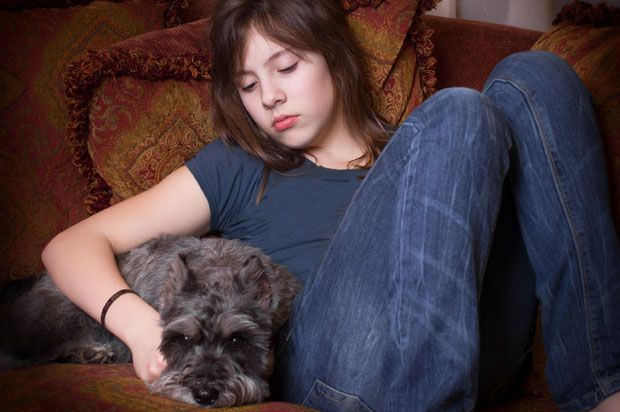 Sad girl with dog