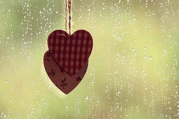 two hearts by rainy window