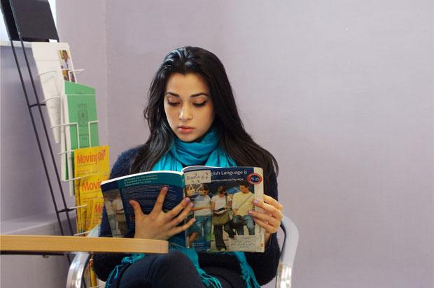 Girl sat reading a text book
