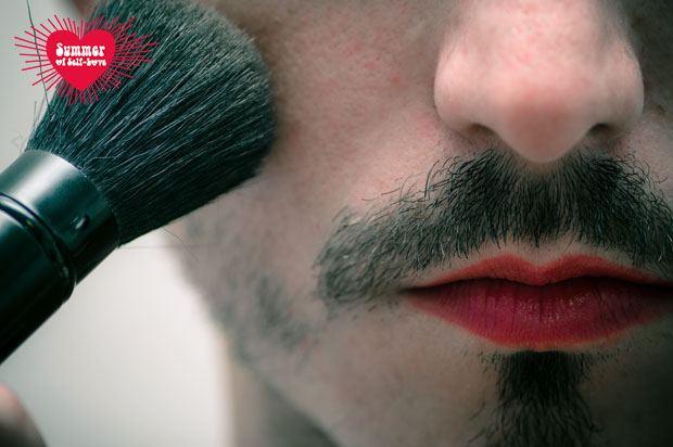 man with beard putting on makeup